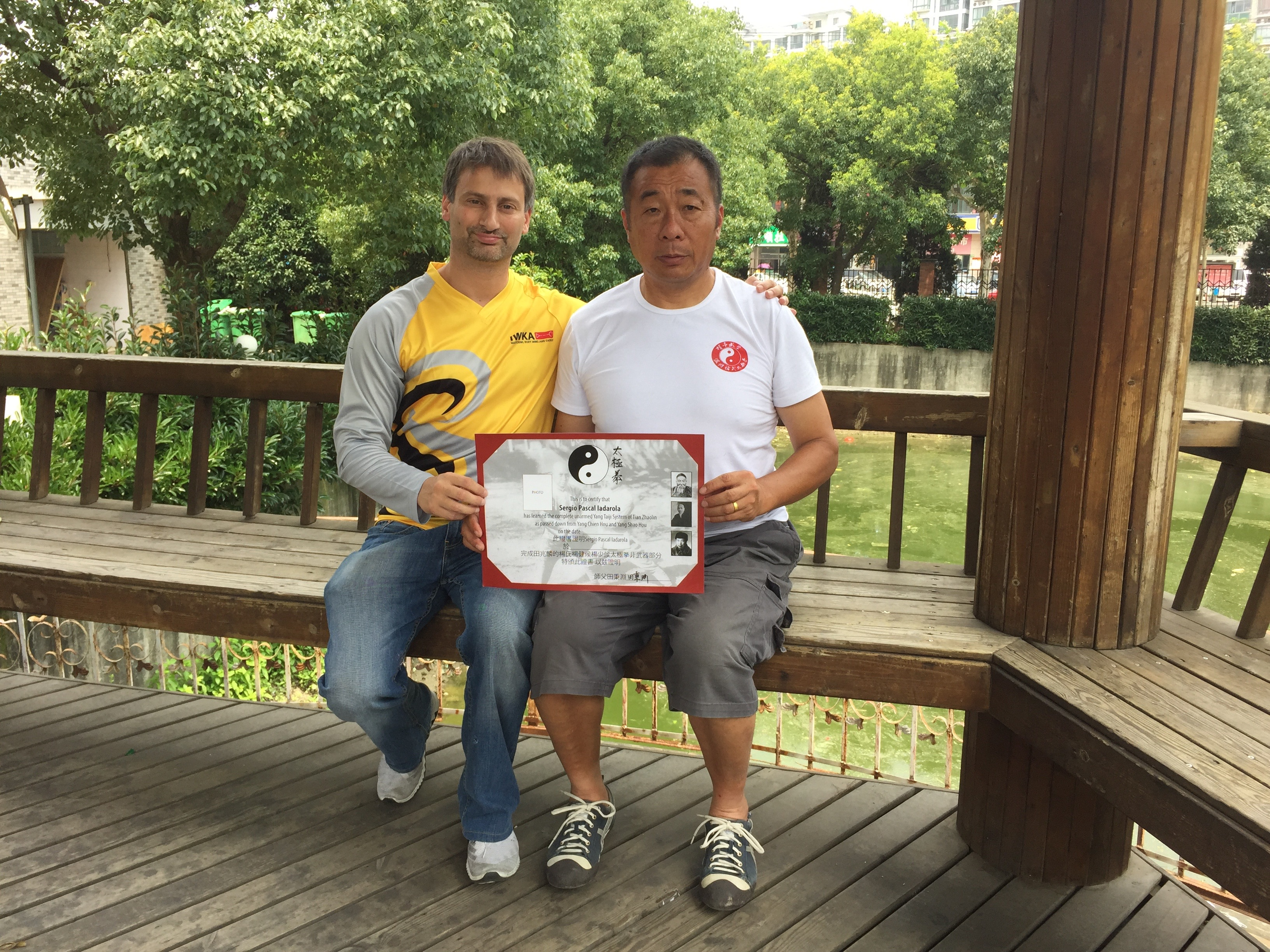 Receiving the certificate of having finished the unarmed curriculum of the Yang Shao Hou and Tian Zhaolin lineage