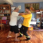 With Sifu Wee Kee Jin practicing the Huang Two Men Sets